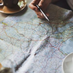 Planning a road trip with a map.